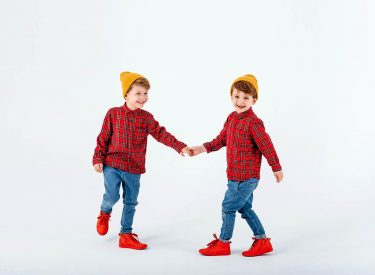 two happy little boys are playing in studio,